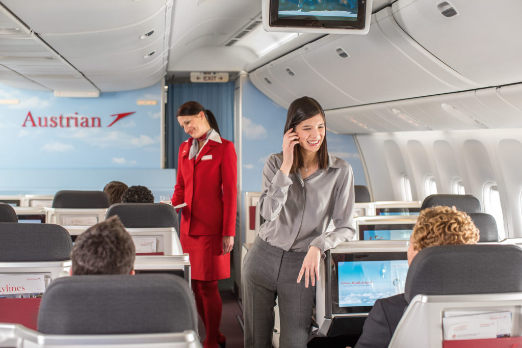 Austrian Airlines business class woman standing