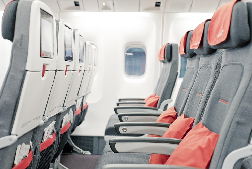 Austrian Airlines longhaul economy class seats with screens and seat pitch