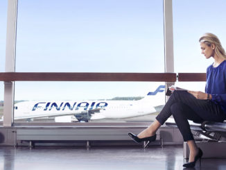 Finnair Airbus A320 with woman at the gate