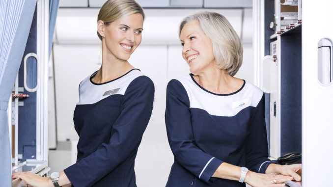 Finnair Airbus A330 with two flight attendants in the galley