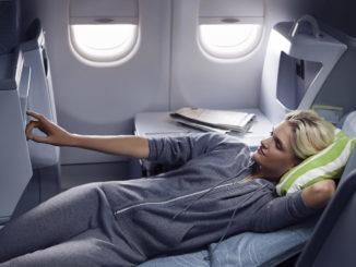 Finnair Business Class Airbus A330 woman resting watching a movie