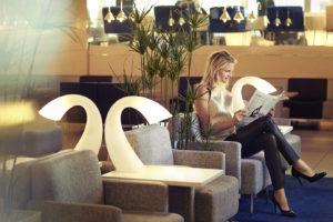 Finnair Business Lounge woman reading a newspaper