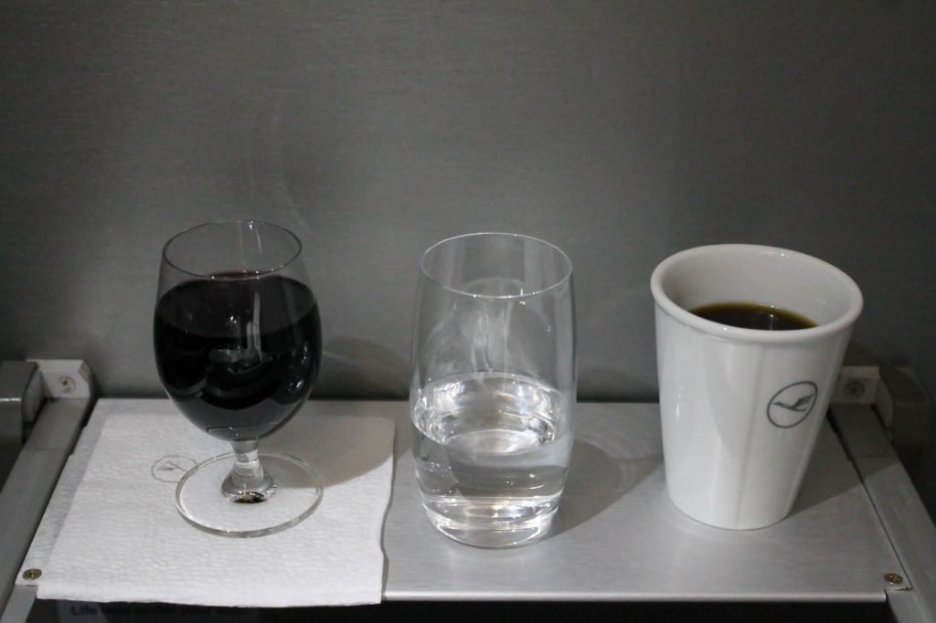 Lufthansa Business Class Stockholm-Munich red wine and coffee