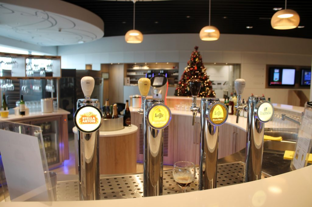 The beer pouring ritual in the Brussels Airlines The Loft Lounge in Brussels