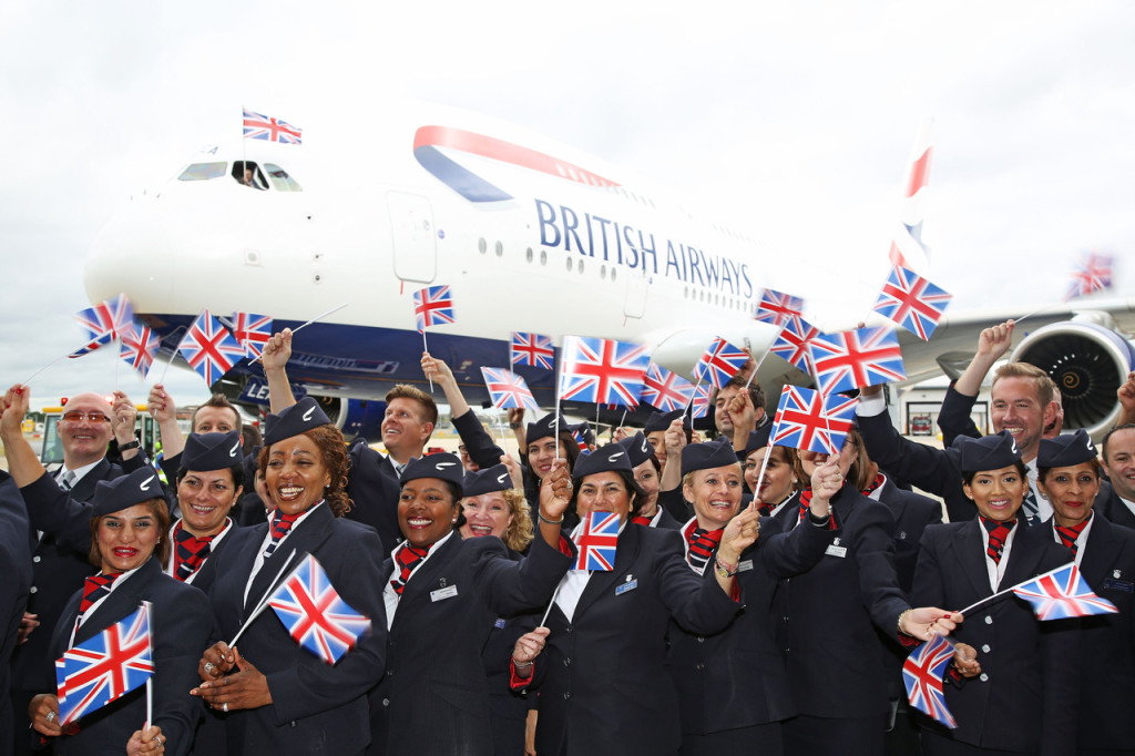 British Airways cabin crew and staff in front of Airbus A380 with British flags