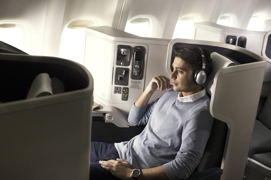 Cathay Pacific Business Class seat with male passenger