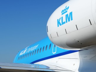 KLM Fokker 70 on the apron with engine and logo