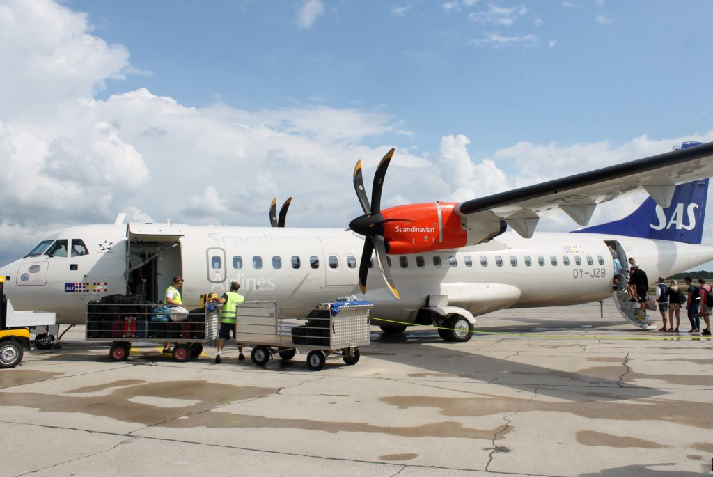 SAS ATR-72 at Visby airport with passengers boarding