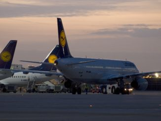 The apron at Frankfurt airport at sunset with Lufthansa aircrafts