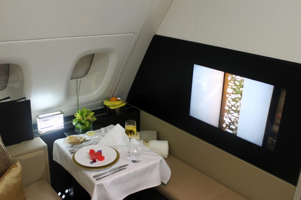 Inside Etihad The Residence dining table and TV