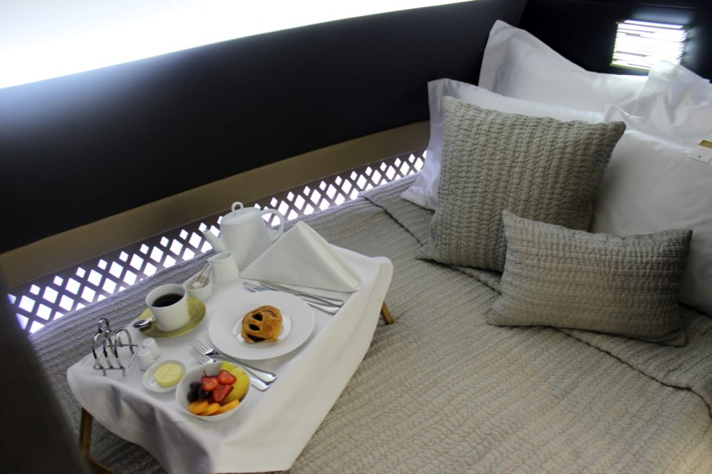 Inside Etihad The Residence bedroom with breakfast tray
