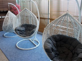 Bubble chairs in the LOT Polonez Lounge at Warsaw Chopin