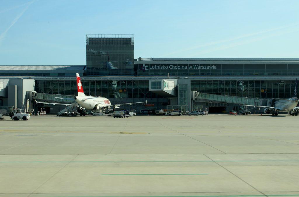 A Swiss aircraft at the terminal building at Warsaw Chopin airport