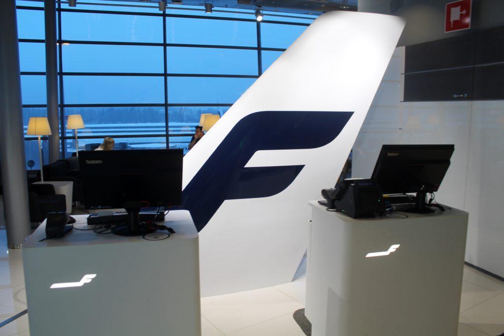 The new Finnair Lounge reception in Helsinki with Finnair tail