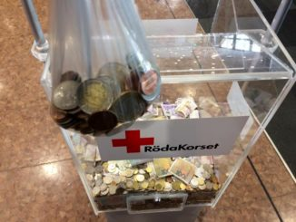 Spare change of different currencies donated to the Red Cross
